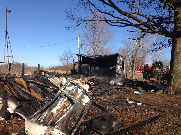 Woman airlifted, trailer destroyed in fire