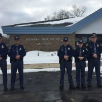 Michigan State Police officers Lt. Matt Kanitz, Sgt. Charles Hockanson, Trooper Dan Thomas, Trooper Brittany Johnson and F/Lt. and Post Commander Jeff White wear the new hats that debuted in conjunction with MSP's 100-year anniversary.
