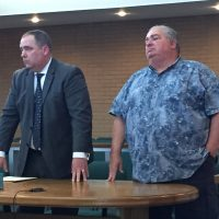 Robet Wilson with his attorney, Timothy Hayes, during a hearing earlier this month.