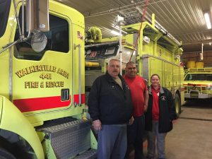Walkerville Assistant Fire Chief Al Purdy, at left, and firefighters Leonard and Leanne Armador.
