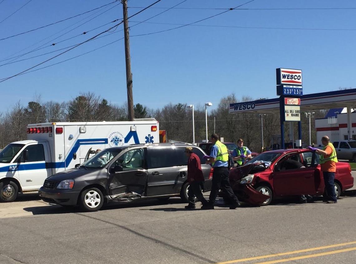 Three hurt in two-vehicle crash.